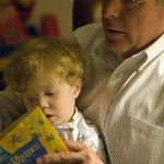 child and man reading